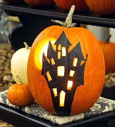 Haunted Mansion    Paint a creepy Haunted mansion on a pumpkin and carve out the windows and a full moon behind it. Love this!