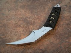Wally Hayes Custom Hawksbill Proto 01 with a large Dragon Menuki and Japanese style wrapped handle and comes with a Ray-skin sheath, 3 7/8 to the Handle wrap and 6 5/8″ overall length – $399.99 sale!