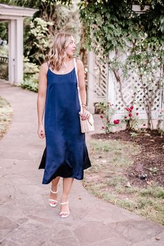 A navy slip dress is a perfect summer staple to have in your closet because it's a versatile dress. It makes for chic a summer outfit that's perfect for a summer date night.  Chic summer dress | chic dress | minimal summer dress | minimal dress | chic outfit | date night outfit