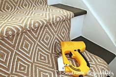 Carpeted runner install on painted stairs