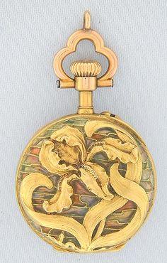 Plique-A-Jour 18K Pentant Watch: Fine, rare and beautiful Swiss plique-a-jour enamel and 18K gold ladies antique pendant watch circa 1890.