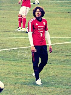 Memo Ochoa his cute i go for him too :) but cr7 wayy more :)