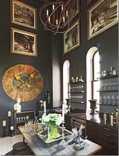 From one of my favorite blogs cote de Texas. These dark walls and art all the way up really charges up the character of this room