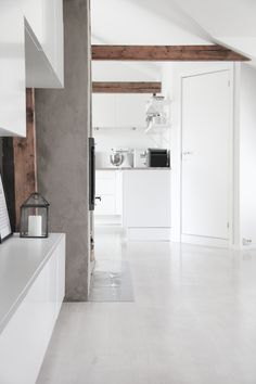 White walls/floor + concrete additions + authentic wooden beams. Clean.