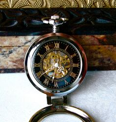 Pocket Watch - Silver & Magnifying Cover, Black Face Gold Roman Numerals, Mechanical Movement on open Steampunk Back, Grooms Men gift. $45.00, via Etsy.
