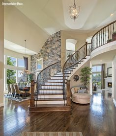 Entry way with open areas alone the top on the second floor.