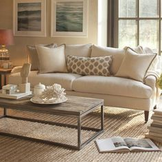 SOFA IDEA: Pierce Sofa by Williams-Sonoma— (my thought: replace current apple green sofas in living room with two of these sofas in the same position as the current, so living room sofas would still face each other toward the new* ottoman)  Like the off-the-floor sofa look to make the room look less heavy.