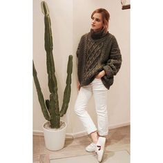 On Emma Watson:Zady sweater; Veja V-10 Sneakers($111). Emma kept her fall look casual, styling her oversize sweater with white jeans and sneakers.