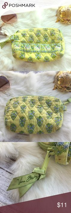 Vera Bradley Mini bag /makeup bag elephant print Yellow green and blue colors. Vera Bradley makeup bag. Lined. Used for makeup. Does have some areas where makeup stained it and a few small holes in the lining. Two different elephants prints inside and out.  •I don't swap/trade •I don't do holds  •I rarely model due to the fact that I don't fit all items.  •I price with shipping in mind  •I am open to reasonable negotiations  •Bundle for the best deals  ☮   ❤️   😊 Vera Bradley Bags Cosmetic…