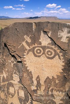 A dramatic wide-eyed shield man occupies a  spot high on a volcanic ridge overlooking the Galesteo River Basin near the village of Galesteo, New Mexico, a few miles from Santa Fe.