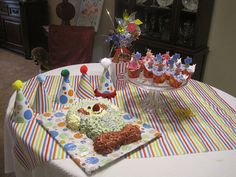 Clown cake with cupcakes