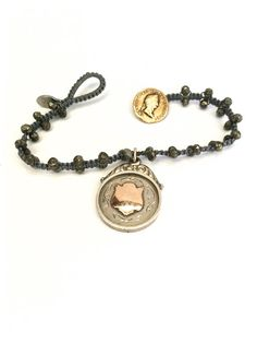 Fribble Pistol hand knotted bracelet with hallmarked silver watch fob...