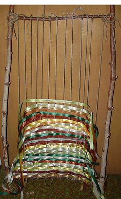 Prayer Weaving | Written prayers on ribbon were woven through handmade loom