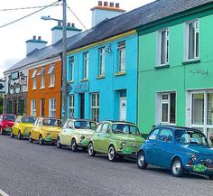 I love these colorful cars...and the happy colors of the houses.