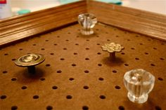 attach small knobs to a peg board for instant jewelry organizer for bracelets or necklaces. For earrings, use a decorated or fabric covered cork board frame inside or a small rod attached to the pegboard. Craft Show Displays, Craft Show Ideas, Display Ideas, Jewelry Holder, Diy Jewelry, Jewelry Tree, Diy Necklace Organizer, Glass Jewelry, Jewelry Box