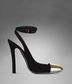 Ultra sexy four-inch heel with brass toe-cap and double ankle strap.  So chichi.