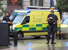 """A knifeman who stabbed three people at a Manchester shopping centre has been arrested on suspicion of terrorism. The suspect, who is in his 40s, was detained and three people were taken to hospital with stab injuries. Eyewitness Terry Ashworth saw a man being arrested during the police response to the incident. In (above) video he took at the scene, the man can be seen lying on the pavement laughing as police restrain him. He tells the police to """"f*** off"""" and calls one a """"pale-faced honky""""."""