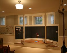 A bay window in a playroom makes a great stage! Magnetic and chalkboard paint make the walls versatile.
