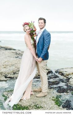 A beach engagement with a twist! | Photographer: Louise Vorster Photography | Flowers : Anli Wahl Flowers & Event Styling | Model : Lindie Meyer | Hair & Make-Up : Minke du Plessis | Cake : The Birdcage | Videographer : Silent Video Productions | Suit : Moi Styling