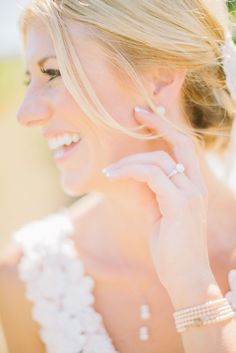 The way light captured this beautiful bride is just breathtaking.  The delicate detail in her accessories and lace dress add to her overall effortless glamour. Photography by Clane Gessel Photography   #weddings #bridalphotos