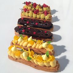Éclairs from my one of my demonstrations today in Sydney @finefoodexpo with @bullafamilydairy & @callebautoz From the top, pistachio & raspberry, chocolate and mango & coconut. #savourschool #kirstentibballs #eclair #pastry #mango #chocolate #pistachio #callebaut #sydney