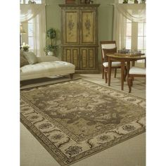 Traditional designs are the hallmarks of this collection of area rugs. Featuring classic traditional patterns, as well as more transitional motifs, there is something here for any decorating preference.