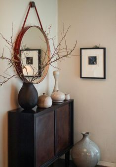 Brad Ford ID, New York Apartment, entrance hall, Edward Wormely for Dunbar cabinet, assorted ceramics, blossom branches