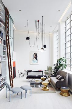 Hanging lights and bright space | @hannahoverbeek