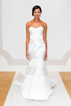 Brides.com: . Wedding dress by Judd Waddell
