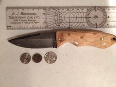 Damascus Hunter with sculpted Sugar Maple Handle copper pins and copper lanyard tunnel