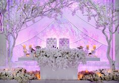 Beautiful white wedding theme. Orchid Head Table Decor with Bride & Groom Chairs