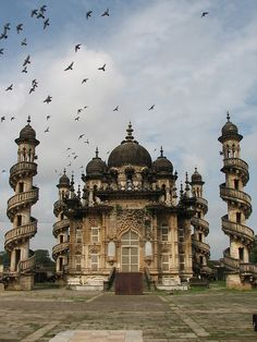 Mohabbat Maqabara, Junagadh, Gujarat, India is a Nawabs royal palace-mausoleum of the late 19th century, a mixture of Indo-Islamic and Gothic architecture.  It is considered a masterpiece of its kind.  by caywinoo. OMG is this place real?!