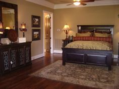 Dark Furniture Gold And Red Bedding With Gold Walls And Bright White Trim