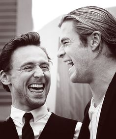 Tom Hiddleston and Chris Hemsworth, actors (Stop smiling. I know you're smiling. Wipe that smile off your face! It's mpossible to stop, right? I know, right?)