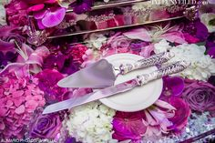 Love decorating the table UNDERNEATH the wedding cake with petals / http://styleunveiled.com Alimario Photography LLC