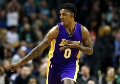 """Nick Young, in Boston. (By Winslow Townson / AP)  Nick Young considered the question: What, exactly, is he? Is he a basketball player? A celebrity? A weird sort of 21st-century icon? """"What would you consider Bobby Brown?"""" Young asked me. I told him I wasn't sure. """"See, like, what would you... http://usa.swengen.com/hes-a-meme-every-night-he-plays-nick-youngs-one-of-a-kind-nba-career-rolls-on/"""