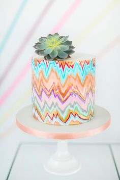 Geometric handpainted wedding cake by Olofson Design  Photography: www.annelimarinovich.com