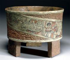 Distinctive incense tripod vessel of Teotihuacan; orange glazed, thin and having three legs.