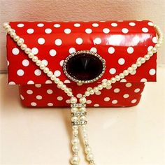 Photo clutch  : Capture any approved image and we'll customize it onto your clutch. This clutch features a polka dot print with removable necklace/handle and gem embellishment.
