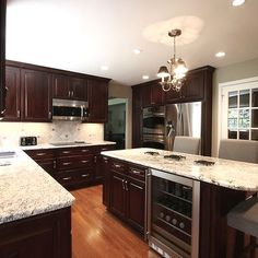 We went for dark wood kitchen designs, and the offer is diversified, so you can pick some of these according to what you wish for for your new kitchen, either built from scratch or that overdue kitchen remodel you have been saving for. Go modern, rustic or minimalist and contemporary, and your kitchen will look great according to our books but remember you have the last saying. The most important part is that among these dark wood kitchen designs you find the kitchen you have been looking… Stained Kitchen Cabinets, Espresso Kitchen Cabinets, Kitchen Cabinets Decor, Kitchen Cabinet Colors, Kitchen Ideas, Wood Cabinets, Kitchen Upgrades, Maple Cabinets, Kitchen Renovations