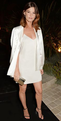 Evening Blazer + Mini Slip Dress = Hanneli Mustaparta's Look  On Mustaparta: Calvin Klein Collection slip dress  Get The Look: Elie Tahari Ava Jacket ($398) in White; Charles Henry...