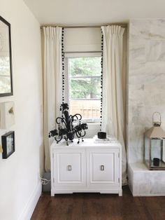 Leaning Chandelier Tutorial Moth Design Blog  Love the Pom Pom curtains