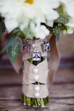 THis is a pretty wedding.  plus I really like the idea of putting photos of loved ones on the flowers.