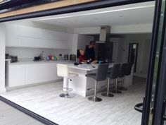 The completed project – a classic installation of our Visofold bi fold doors and a very happy customer.