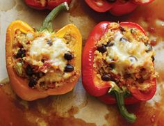 Mexicanish Stuffed Peppers (secretly healthy because they're made with quinoa). Vegetarian-friendly.