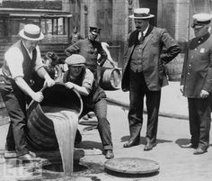 Prohibition: How Dry We Ain't via life.com: New York City's Deputy Police Commissioner John A. Leach (far right) watches agents pour liquor into a city sewer following a raid on a speakeasy. Under pressure from religious groups (primarily Methodists), in 1881 Kansas became the first American state to outlaw alcohol. Several southern states followed suit in the years that followed, and by 1919, there was enough support for complete prohibition—or at least enough vocal support—among the public that the U.S. Senate proposed a constitutional amendment to that effect in 1917. The amendment was ratified in January of 1919. #Prohibition #life