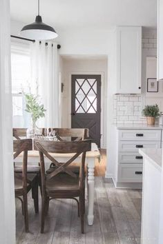 farmhouse interior white kitchen with wood floors