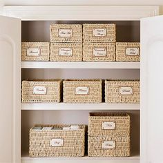 In a hallway closet, baskets with detailed labels make it easy to find toiletries. - i so need to do this!