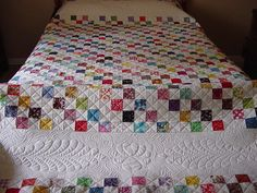 I like this. It's so simple that it gives way to intricate quilting to set it off just right. Great stuff, this.