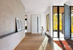 Modern White Entry with Plaster Stool